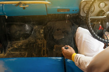 Man Hand On Manual Gear Of Old Car. Man Changing Gear While Driving A Workable Vintage Old Car.