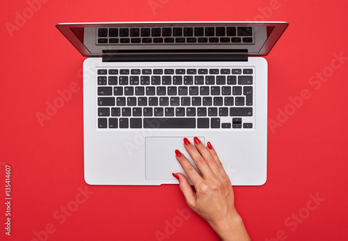 canvas print motiv - ArtFamily : Hand touching touchpad on the silver laptop