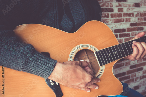 Fotografie, Tablou  Close up a man playing guitar