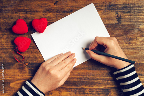 Fotografie, Obraz Woman writing love letter for Valentines day