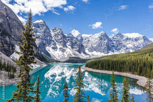 Foto op Canvas Canada Moraine lake in Banff National Park, Canadian Rockies, Canada. Sunny summer day with amazing blue sky. Majestic mountains in the background. Clear turquoise blue water.