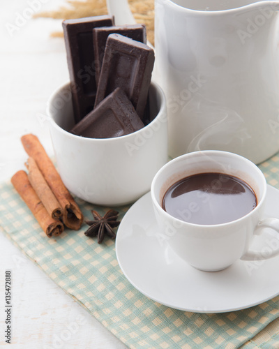 Foto op Canvas Chocolade Hot Chocolate in white cups with Chocolate bar on the wooden table