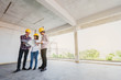 three construction engineers working together in side building p