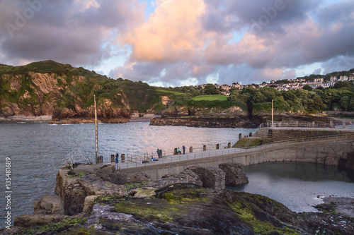 Foto auf Gartenposter Stadt am Wasser The harbor in Ilfracombe. Fishermen catch fish. Evening. North Devon Coast. UK