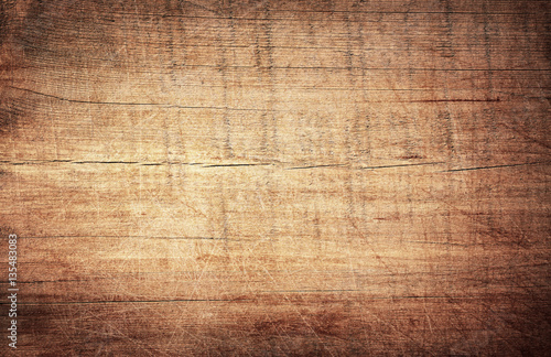 Tuinposter Hout Brown scratched wooden cutting board. Wood texture
