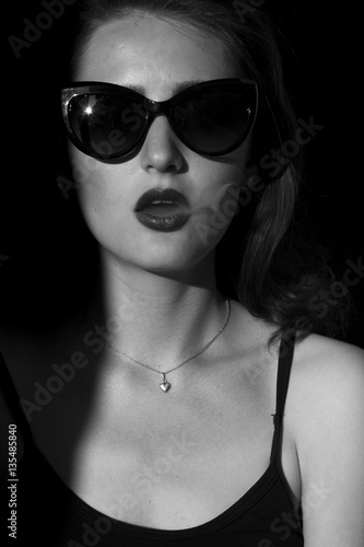 f5a345d2f a beautiful girl standing in the shade. Girl in the sun smoking cigarettes  and let