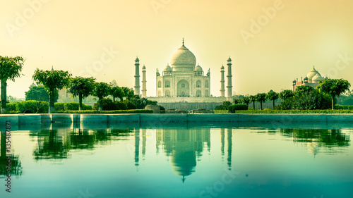 Fotografie, Obraz  Taj Mahal with reflection in water in early morning from Mehtab bagh