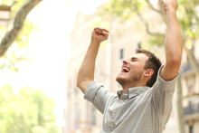 Excited Man Raising Arms In The Street