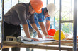 Construction concepts, Engineer and Architect working at Construction Site with blueprint