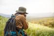 Traveler photographer with digital camera on mountain.