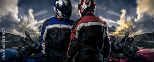 Photo Stands Motor sports HDR composite of bikers or motorcycle riders with motor bikes on a road. The men depict a club or are competitors in a race. The image depicts racing and motorsports.