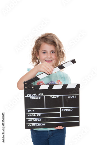 Young girl with clapperboard Fototapeta