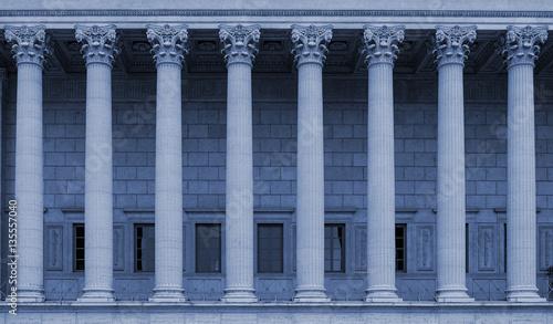 Fotografering Corinthian columns in a colonnade of a building facade