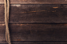 Vintage Background With Old Rope On Wood Planks