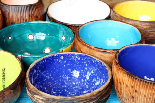 Many Different Bright Multicolored Ceramic Bowls And Cups