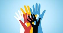 Multicolored Volunteers Hands ...