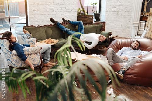 Fotografie, Obraz  Handsome attractive men sleeping in the living room