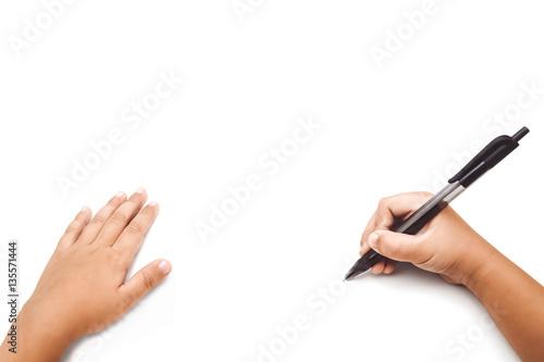 kid's hand writing on white