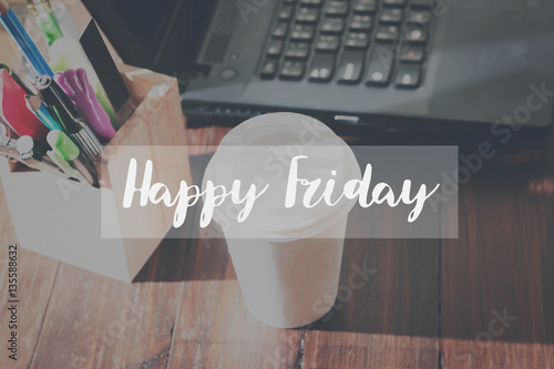 Fotografia  Concept Happy friday message on the device works the table background