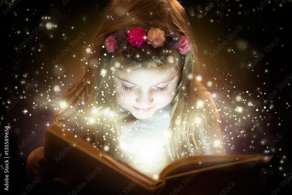Fototapeta Beautiful little girl reading magic book