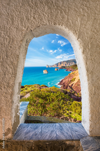 View from an archway leading to a Mediterranean west cost of Sardinia Canvas Print