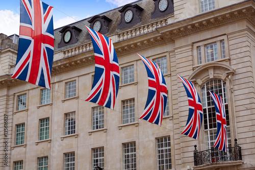 Fototapeta London UK flags in Piccadilly Circus