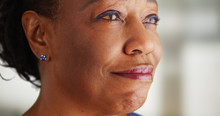 A Close-up Of An Older Black Woman Being Very Happy