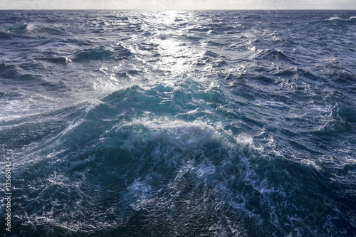 Fotografie, Obraz  Rough turbulent ocean under reflective sun