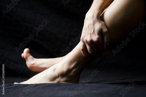 Foto op Canvas School de yoga Woman legs with dark background
