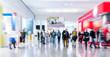 Leinwanddruck Bild blurred business people at a trade fair stock photo