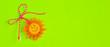 Leinwanddruck Bild - Bulgarian Martenitsa spring sign and sun on green banner background