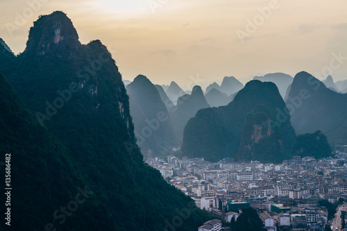 Foto op Aluminium Guilin The view at the dawn of the cityscape and karst rock mountains in Yangshuo, Guilin region, Guangxi Province, China.