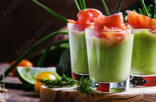 Photo sur Toile Entree Appetizer with smoked salmon and avocado mousse, served in glass