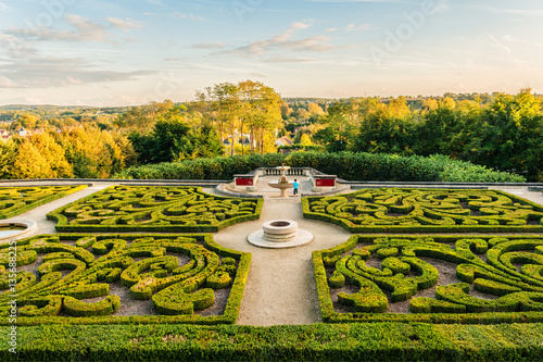 Castle of Auvers-sur-Oise in garden. Sunset. Val-d'Oise, France. Canvas Print