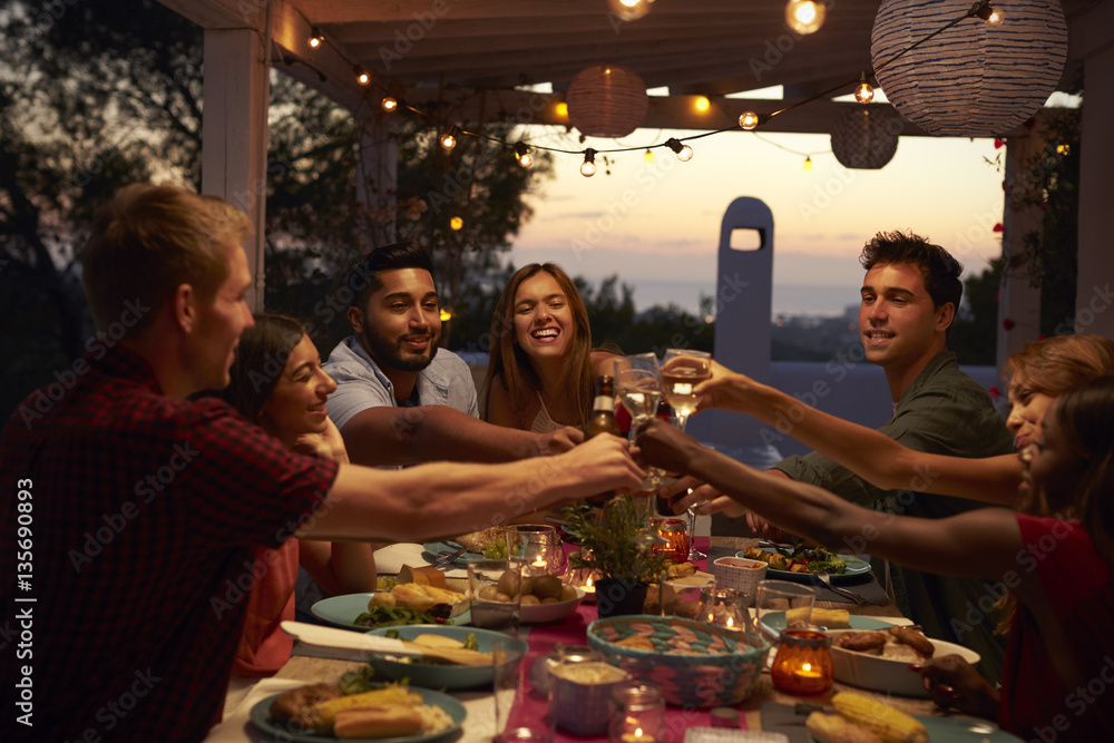 Fototapety, obrazy: Friends make a toast at a dinner party on a patio, close up