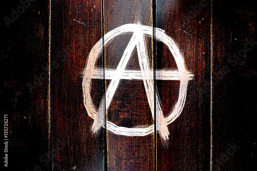 Vintage Anarchy sign on a grunge wooden panel Canvas Print