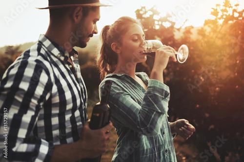 Cuadros en Lienzo  Romantic couple in vineyard before harvesting