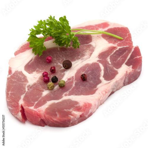 Staande foto Vlees Raw pork neck chop meat with parsley herb leaves and peppercorn