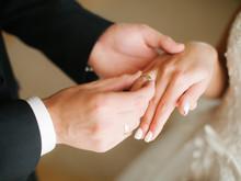 Bride Wear Ring On Groom's Finger