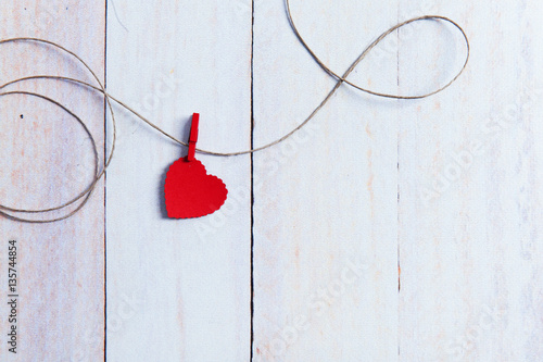 Fotografia  heart on the clasp and cord relationship with the space for text