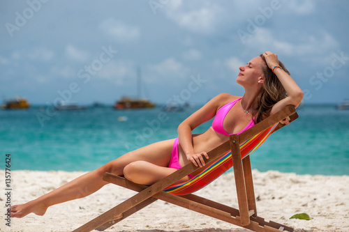 Deurstickers Ontspanning Woman in lounger on tropical beach