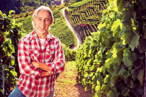 Fotografía  Winemaker Standing By His Vineyard
