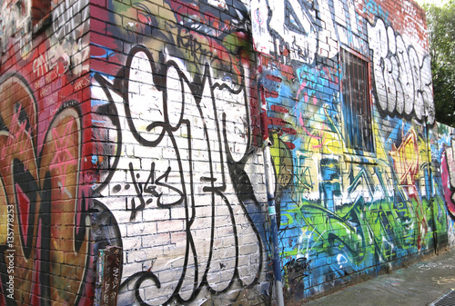 Photo Stands Graffiti MELBOURNE, AUSTRALIA - May 27, 2015: Colourful street art on the wall of a building in a Fitzroy alleyway
