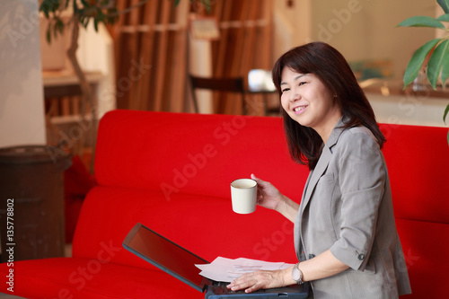 Photographie  business woman taking a break