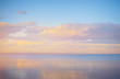 Sky background on sunset, seafront. Nature composition. Panoramic sunset sky background. Taganrog Bay, Azov sea. Beautiful sunset over sea with reflection in water, majestic clouds in the sky.