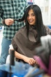 Young smiling woman in hair salon.