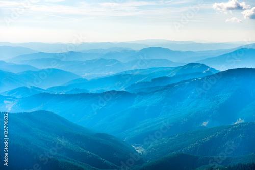 Photo sur Aluminium Piscine Landscape with blue mountains