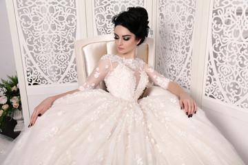 Naklejka gorgeous bride with dark hair in luxuious wedding dress