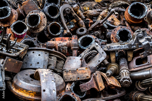 Pile of Used machine parts are oily and rusty in second hand