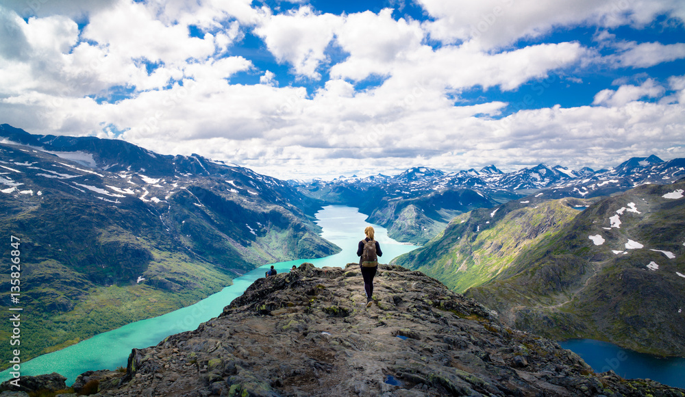 Fototapety, obrazy: Young woman hiking in the mountains. Besseggen, Jotunheimen, Norway